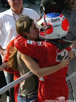 Race winner Rubens Barrichello celebrates