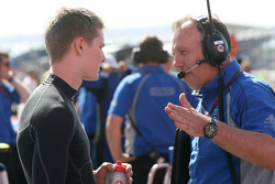 Josef Newgarden talks to an engineer