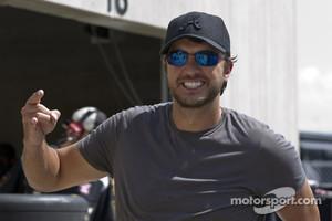 Luke Bryan walks around in the garage area