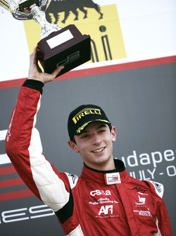 Alexander Rossi celebrates victory on the podium