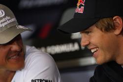 Michael Schumacher, Mercedes GP, Sebastian Vettel, Red Bull Racing