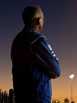 Crew member for Kurt Busch, Penske Racing Dodge watches the race