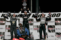 Podium: race winner Helio Castroneves, Team Penske, second place Ed Carpenter, Panther Racing/Vision, third place Dan Wheldon, Panther Racing