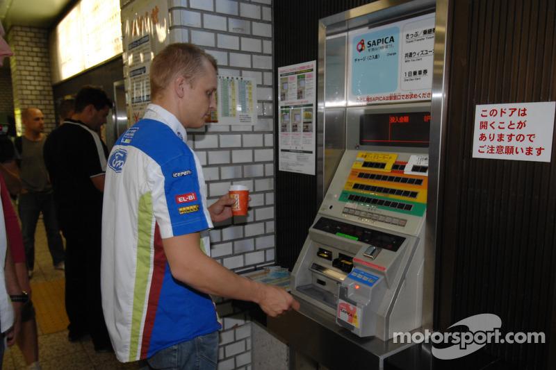 Mikko Hirvonen buys subway tickets in Sapporo