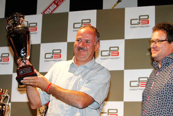 Andreas Jenzer from The Jenzer Motorsport team receive the trophy for 3rd overall in the Championship