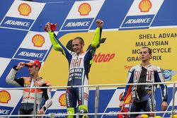 Podium: race winner Valentino Rossi, Fiat Yamaha Team, second place Andrea Dovizioso, Repsol Honda Team, third place and 2010 MotoGP champion Jorge Lorenzo, Fiat Yamaha