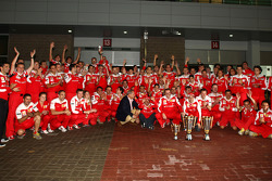 Race winner place Fernando Alonso, Scuderia Ferrari celebrates with Felipe Massa, Scuderia Ferrari, and Scuderia Ferrari team members