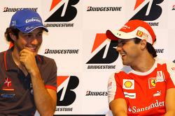 Bruno Senna, Hispania Racing F1 Team and Felipe Massa, Scuderia Ferrari during the Bridgestone conference