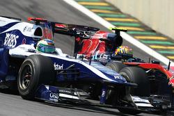 Rubens Barrichello, Williams F1 Team and Jaime Alguersuari, Scuderia Toro Rosso