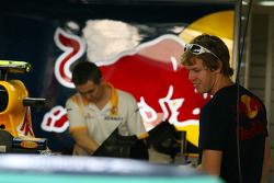 Sebastian Vettel, Red Bull Racing taking a look at Mark Webber's car
