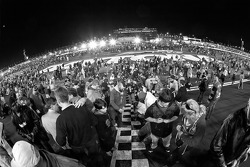 Fans write messages on the start-finish line