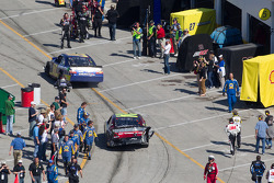 Joe Nemechek, NEMCO Motorsports Toyota and Jeff Gordon, Hendrick Motorsports Chevrolet head to the garage