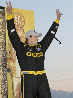 Morgan Lucas celebrates on stage in the winners circle after winning the Top Fuel category at the Kr