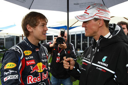 Sebastian Vettel, Red Bull Racing and Michael Schumacher, Mercedes GP Petronas F1 Team