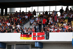 Sebastian Vettel, Ferrari and Kevin Magnussen, Renault Sport F1 Team fans in the grandstand