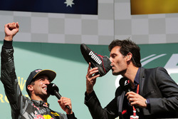 (L to R): Daniel Ricciardo, Red Bull Racing celebrates his second position on the podium with Mark Webber, Porsche Team WEC Driver / Channel 4 Presenter, who drinks champagne from Daniel's race boot