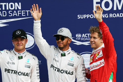 Qualifying top three in parc ferme (L to R): Nico Rosberg, Mercedes AMG F1, second; Lewis Hamilton, Mercedes AMG F1, pole position; Sebastian Vettel, Ferrari, third