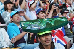 A fans in the grandstand with the map of the circuit on his head