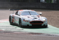 In a very sandy Villeneuve Chicane; most cautious #8 Young Driver AMR Aston Martin DB9