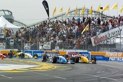 Paul  Tracy leads Sébastien Bourdais into turn 1
