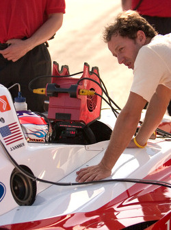 Cristiano da Matta works with teammate Jimmy Vasser