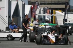 Newman Haas Racing crew members unpack car