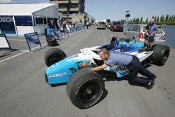 Forsythe Racing crew members unpack car