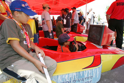 Young fans try racing sim