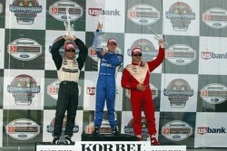 Podium: race winner A.J. Allmendinger with Bruno Junqueira and Oriol Servia