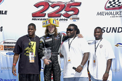 Podium: Third place Nelson Philippe poses with members of the Green Bay Packers