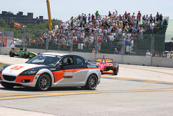 The pace car leads the field from the pit lane