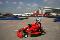 Roger Clemens on track in a go-kart