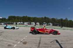 Sébastien Bourdais and Graham Rahal leave the pits