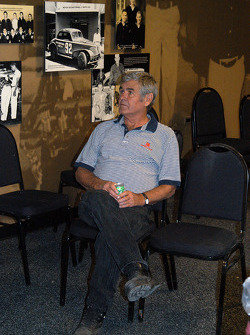 Al Unser, Sr. takes a break from unwrapping chairs