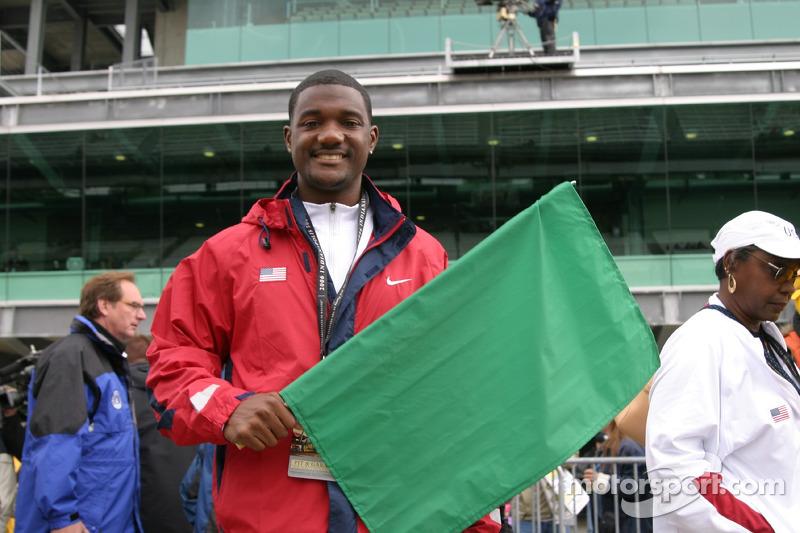 Le détenteur du record du monde du 100m Justin Gatlin prépare à aîter le drapeau vert