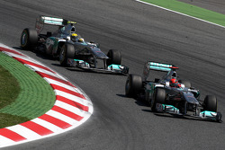 Michael Schumacher, Mercedes GP Petronas F1 Team leads Nico Rosberg, Mercedes GP Petronas F1 Team