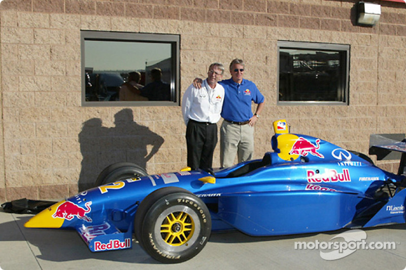 Eddie Cheever and Team Manager, Richard Caron, stand behind the Red Bull, Infiniti powered Cheever Indy Racing car