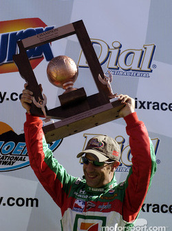The podium: race winner Tony Kanaan