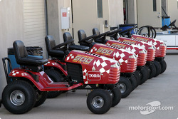 Toro tractors lined up in the garage area