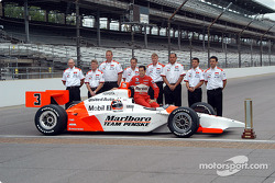 Pole winner Helio Castroneves with his team