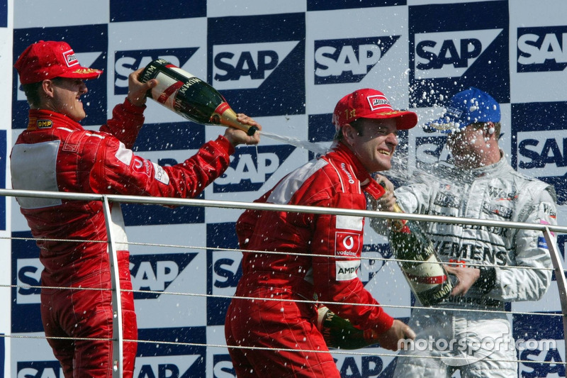 2002 (Індіанаполіс). Подіум: 1. Рубенс Баррікелло, Ferrari. 2. Міхаель Шумахер, Ferrari. 3. Девід Култхард, McLaren-Mercedes