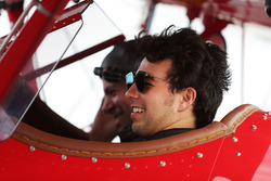Sergio Perez, Sahara Force India F1 takes a flight in a biplane