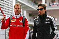 (L to R): Sebastian Vettel, Ferrari with Sergio Perez, Sahara Force India F1