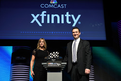 Jill Gregory, NASCAR Senior Vice President and Chief Marketing Officer, and Matt Lederer, Comcast Executive Director Sports Brand Strategy, pose with the NASCAR Marketing Achievement Award during the NASCAR NMPA Myers Brothers Awards Luncheon