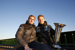 World Champion Nico Rosberg celebrates with Bernd Schneider