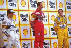 Podium: racewinnaar Nigel Mansell, Williams, tweede plaats Nelson Piquet, Williams, derde plaats Ayrton Senna, Team Lotus