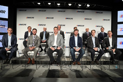 NASCAR drivers and executives sit on stage during a press conference outlining the changes to the 2017 Monster Energy NASCAR Cup Series