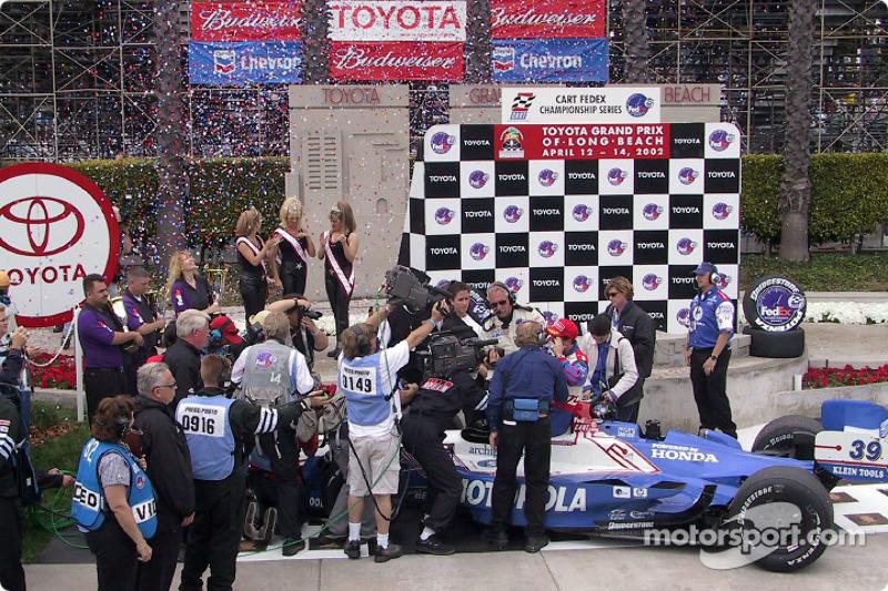 Victory circle: race winner Michael Andretti