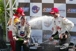 The podium: champagne for Cristiano da Matta, Christian Fittipaldi and Jimmy Vasser