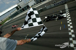 Sébastien Bourdais takes the checkered flag ahead of Mario Dominguez and Michel Jourdain Jr.